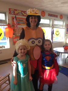 Miss Carole with some students  and their great costumes on Halloween!
